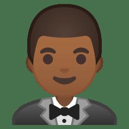 Man in tuxedo medium dark skin tone icon