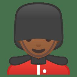 Man guard medium dark skin tone icon