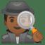 Man detective medium dark skin tone icon